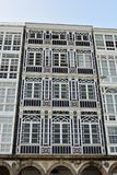 Facade detail: Windows with white wood galleries and modernist style. royalty free stock photo