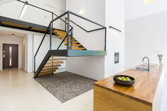 Modernistic interior with massive staircase Royalty Free Stock Image