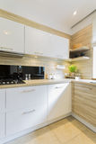 Modernity in a kitchen room. Shot of a beautiful and full of light kitchen interior stock image