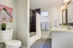 Modernized bathroom with tile floor. Modernized bathroom with full bath and shower, also tile floor Stock Photography