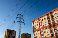 Modernized block of flats originally built in communism era in Havirov, Czech Republic. With a pylon transfering electricity through wires stock photography