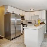 Modernized kitchen with grey and white theme. Royalty Free Stock Photos
