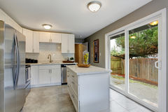 Modernized kitchen with grey and white theme. Royalty Free Stock Photography