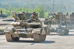 Modernized tank T-72 and convoy in motion. Russia Royalty Free Stock Photos