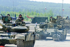 Modernized tank T-72 and convoy in motion. Russia Stock Images
