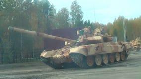 Modernized tank T-72 in motion. Russia. Nizhniy Tagil, Russia - September 25. 2013: Modernized tank T-72 moves on the shooting demonstration range. RAE-2013 stock video footage