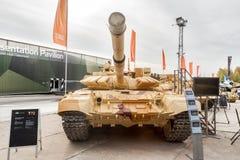 Modernized tank T-72. Russia. Nizhniy Tagil, Russia - September 25. 2013: Visitors explore military equipment on exhibition range. T-72. Modernized tank. RAE Royalty Free Stock Photography