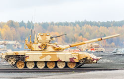 Modernized tank T-90s. Russia. Nizhniy Tagil, Russia - September 25. 2013: Modernized tank T-90s. It moves on the shooting demonstration range. Russia Arms Expo Royalty Free Stock Photography
