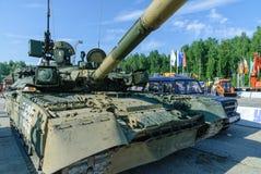 Modernized tank T-80U. Russia. Nizhniy Tagil, Russia - July 12. 2008: Visitors examine military equipment on exhibition range. T80U modernized tank. Russian Arms Stock Photography