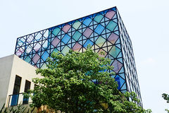 Modern building with colorful glass curtain Stock Photos