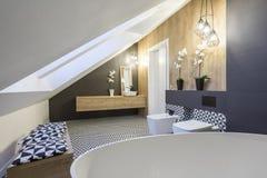 Modernly designed attic bathroom. With bathtub royalty free stock photography