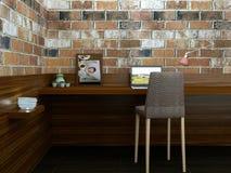 Modernt arbetsställe i tomt rum med tegelstenväggen Arkivfoton