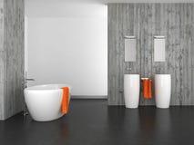 Modernt badrum med betongväggen och det mörka golvet Royaltyfri Bild