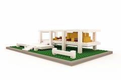 Modernt hus som göras av plast- tegelstenar Arkivbilder