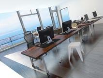 Modernt minimalist kontor som förbiser havet Fotografering för Bildbyråer