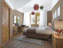 Modernt sovrum i stilen av moderna nattduksbord med Arkivbild