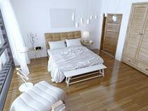 Modernt sovrum med den bruna säng- och vitväggen Arkivfoton