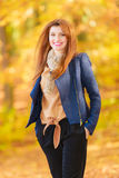 Modest girl in autumnal enviroment. royalty free stock image