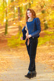 Modest girl in autumnal enviroment. royalty free stock photos