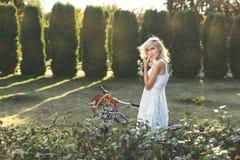 Modest girl in white dress. Royalty Free Stock Photos