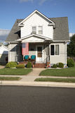 Modest House. A modest house with an American flag, in a small town Stock Photos