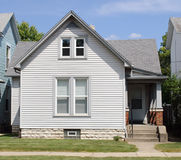 Modest House with Porch. Old, gray, modest Midwest house with side porch Royalty Free Stock Image