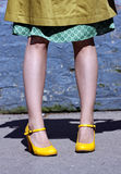 Modest model in yellow shoes Stock Image