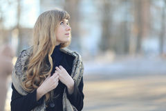 Modest shy girl at spring street Royalty Free Stock Photography