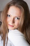 Modest smile. On face of beautiful girl. Soft portrait Stock Images
