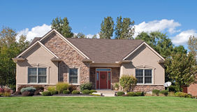 Modest Stone & Stucco House. Modest-sized Midwest house with tan stone and stucco exterior stock image