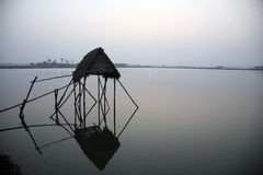 Modest straw hut of Indian fishermen in the Ganges, Sunderband, India Royalty Free Stock Photos