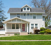 Modest Two Story Home. Older, modest two-story home with vinyl or aluminum siding stock image