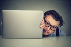 Free Modest Young Man Hiding Behind Laptop Royalty Free Stock Images - 108410489