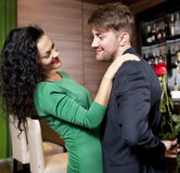 The modest young man with a rose and its girlfriend. Appointment in cafe Stock Photography