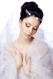 Modest young woman with closed eyes isolated on white studio background dressed in the cape of organza and beautiful tiara Royalty Free Stock Image