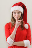 Modesty girl weared in santa showing the silence sing. Christmas and New Year concept Stock Photo