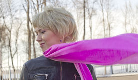 Modesty on walk. The young woman with a pink scarf walks in park Royalty Free Stock Photo