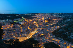 Modica cityscape at blue hour. Large cityscape view of Modica at blue hour, a small beautiful baroque town located in the south east of Sicily Royalty Free Stock Photo
