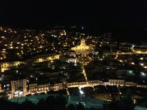 Modica Sicily by night. Panoramic view of the city of Modica in Sicily by night. The church in the middle is the Saint George church Stock Image