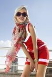 Modieus meisje in rode kleding stock foto's