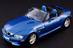 Modieuze blauwe covertible open tweepersoonsauto Stock Afbeelding
