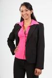 Modieuze jonge bedrijfsvrouw die donker kostuum draagt Stock Foto