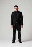 Modieuze mens in zwart kostuum Royalty-vrije Stock Afbeelding
