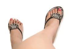 Modieuze sandals en voeten Stock Foto's