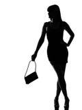 Modieuze silhouetvrouw het wachten holdingsbeurs stock afbeeldingen