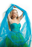 Modieuze vrouw in een blauwe kleding stock fotografie