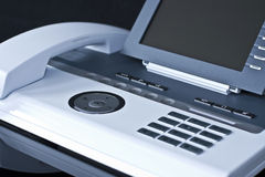 Modieuze witte bureautelefoon royalty-vrije stock foto