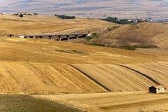 Modific il terrenoare in Basilicata (Italia) all'estate Fotografia Stock