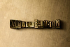MODIFICATION - close-up of grungy vintage typeset word on metal backdrop. Royalty free stock illustration.  Can be used for online banner ads and direct mail Royalty Free Stock Photos