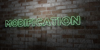 MODIFICATION - Glowing Neon Sign on stonework wall - 3D rendered royalty free stock illustration. Can be used for online banner ads and direct mailers Stock Photography